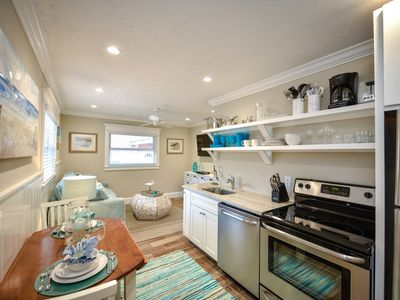 Photo for Tropical Breeze Resort - Large 1 Bedroom Suite - Sleeps 4 - Perfect Location. Walk Everywhere. Private Patio. INCLUDED: Daily Housekeeping, Bikes, 2 Pools/1 Spa, Beach Chairs, Beach Towels, WiFi, Parking , Games, BBQs and More!
