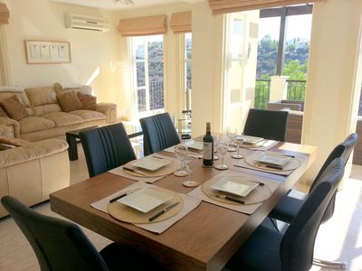 The dining table with room for up to eight people (two extra chairs provided).