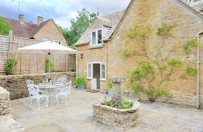 Photo for Weir Cottage is a traditional Cotswold stone cottage, located in the heart of Bourton-on-the-Water