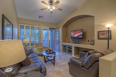 Well appointed great room with new tile floors is arranged for TV viewing or conversing with your favorite people