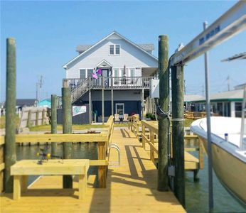 Photo for Soundfront with Dock, hot tub, close to beach & quaint downtown area - Sea Chase