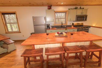 Kitchen with reclaimed wood counter tops and large island