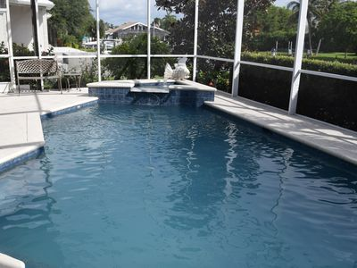Photo for WELCOME TO PARADISE! MARCO ISLAND POOL HOME W/DOCK ON WIDE CANAL, BOAT FRIENDLY!