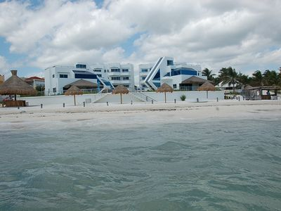 Photo for 2 Bedroom Luxury Condo 75 yards from the Caribbean