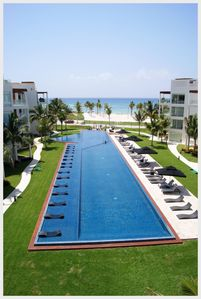 Photo for BEACH FRONT + GROUND FLOOR + GYM + PRIVATE BEACH CLUB + BUSINESS CENTER