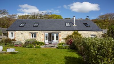 Photo for Luxury Detached Barn, open plan, sea views, sunny garden, ideal for couples.