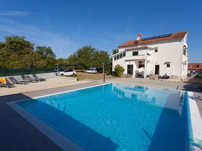 Photo for Beautiful family apartment Arbanas with pool and large garden, close to the sea