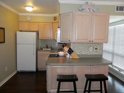 Lots of storage in this fully stocked kitchen-blender and coffee maker included!