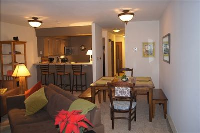 Open floor plan with dining room table that seats up to 8.