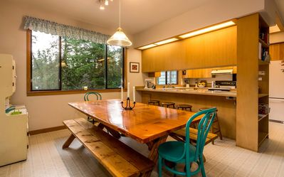Dining area with large, hand-made table.  comfortably seats 8-10. View of bay.
