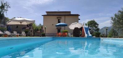 Photo for Villa with pool surrounded by greenery