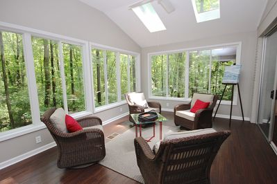 Sunroom is your  window  to nature. Swivel  rocking chairs add to the comfort.