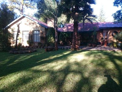 Photo for 4 bedroom bungalow set in beautiful garden