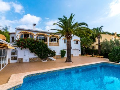 Photo for This 7-bedroom villa for up to 14 guests is located in Javea and has a private swimming pool and air