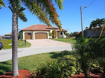Photo for Rosalinda - Cape Coral 3b/3,5ba  luxury home w/electric and solar heated pool/spa, gulf access canal