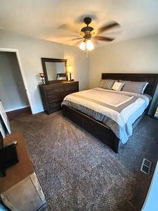 master bed room with King bed, bay windows looking backyard, cable TV, full bath