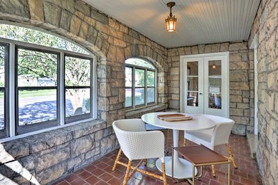 Snack on appetizers and sip wine in this bright and airy sunroom.