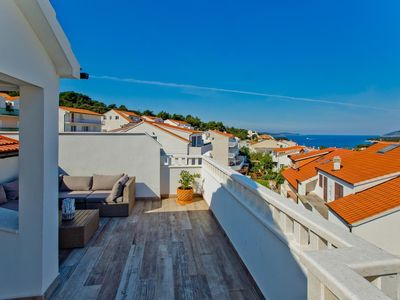 Photo for Two bedroom apartment with terrace and sea view Hvar (A-5706-c)