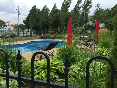 Photo for 4 people, 2 bedrooms with view of the St. Lawrence River, heated pool.