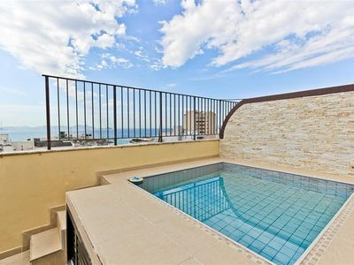 Photo for Charming duplex penthouse with pool, view and close to the beach!