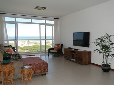 Photo for Beautiful apartment in front of the sea with view of the beach - 3 suites for 8 people