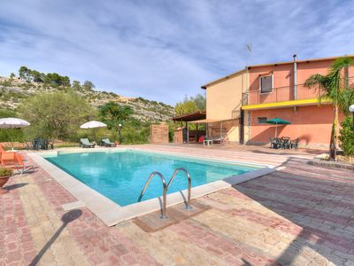 Photo for A house located into lush Mediterranean vegetation and olive trees.