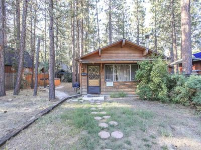 Photo for Romantic Getaway - Walk to Snow Play!!  Woodsy getaway cabin with hot tub!