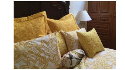 Your hostess designed and made the sunflower-theme bedding.