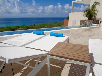 Private 30' infinity edge lap pool overlooking Caribbean ocean