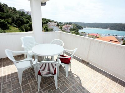 Photo for Two bedroom apartment with terrace and sea view Kampor (Rab) (A-5018-b)