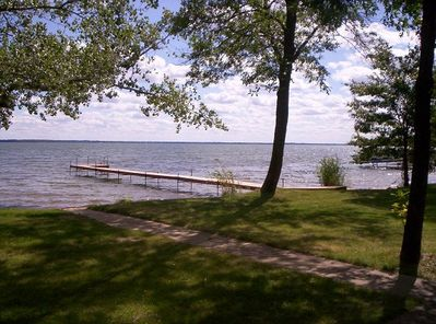 Lake side with dock, boat lift and canoe provided