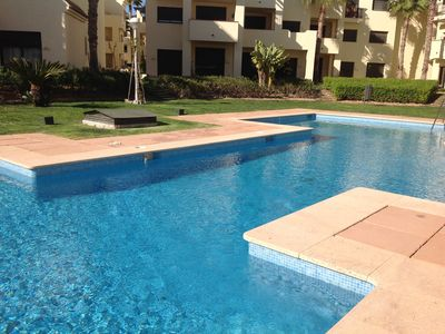 Photo for Luxury Ground Floor Apartment with Double Patio by Pool