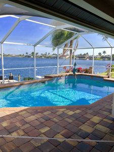 Photo for Spacious Tropical Waterview While Relaxing In Your Pool!