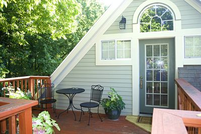 Private deck featuring a bench as well as a table and chairs!