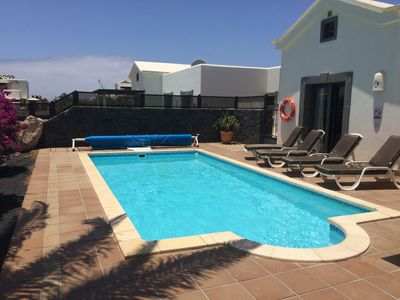 Photo for Beautiful private villa with heated pool, Wi-Fi, tropical garden and sun terrace