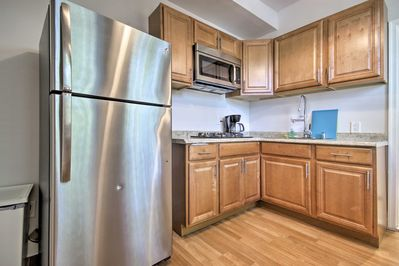 Walk to the grocery store and stock this well-equipped kitchen the way you like!