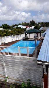 Photo for Homerez last minute deal - Nice bungalow with shared pool