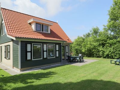 Photo for Holiday home with terrace and garden in a holiday park just outside Zonnemaire
