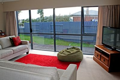 Large glass doors and windows in the living space