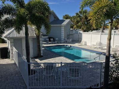 Amazing pool just behind the condo. Never crowded. Laundry hut with W/D too.