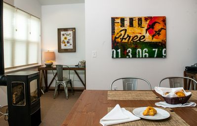 The Spinnaker Studio includes a dining area with chairs for four.