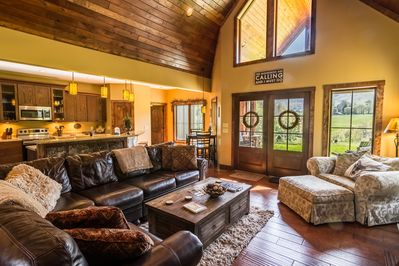 Living room with leather and suede furniture, gas log fireplace and TV