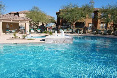 One of 3 stunning pools, this one just steps from condo!