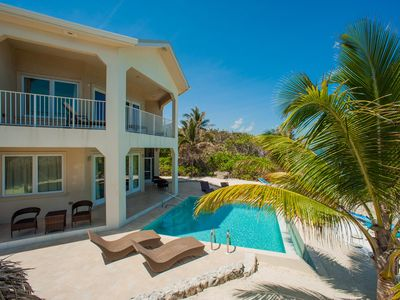 Photo for Christmas Palms: Serene Villa with an Oceanfront Pool and Private Beach