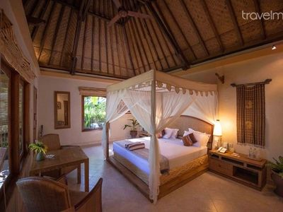 Photo for Traditional Beachfront Balinese Cottage