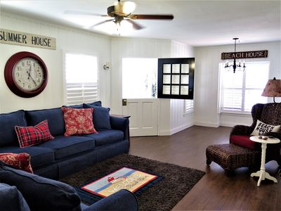 This home features an open, airy living room with comfortable co