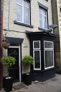 Photo for Large traditional house in the heart of old Staithes. Lovely outside deck