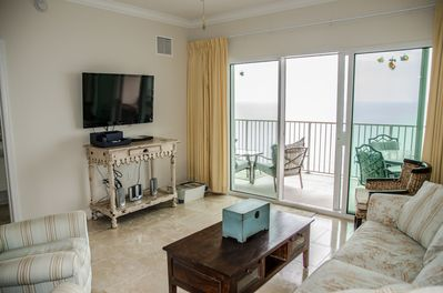 Family room overlooking Gulf with flat screen TV and DVD player
