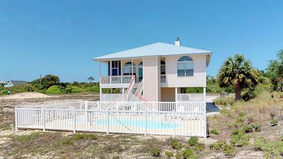 """Photo for Ready to Rent Now! FREE BEACH GEAR! Gulf Beaches, Pool, Screen Porch, Elevator, Wi-Fi, 3BR/2BA """"The Painted Bird"""""""