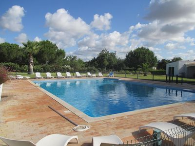 View over pool towards Villa 2